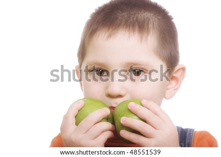 Boy with two green apples against white background