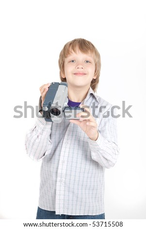 Boy with video camera - stock photo