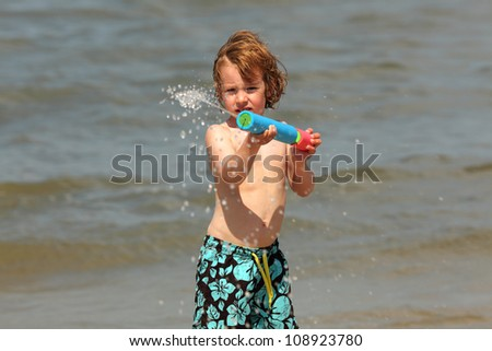 boy with water gun - stock photo