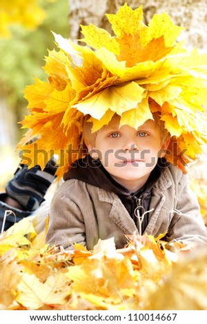 boy with yellow autumn leaves