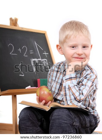 Boy writing on the blackboard