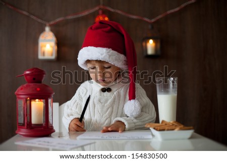 Boy, writing to Santa