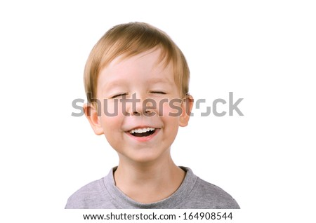 boy 5 years laughing with eyes closed. isolated on white background - stock photo