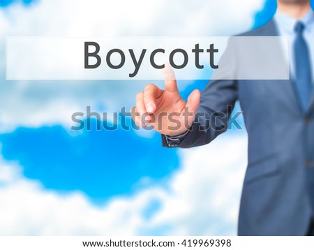 Boycott - Businessman hand pressing button on touch screen interface. Business, technology, internet concept. Stock Photo