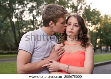 boyfriend beg forgiveness from his offended girlfriend - stock photo