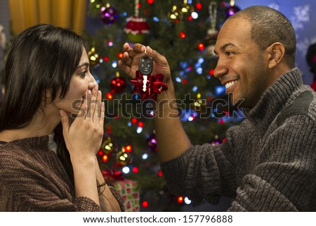 Boyfriend giving girlfriend expensive gift for holidays, horizontal - stock photo