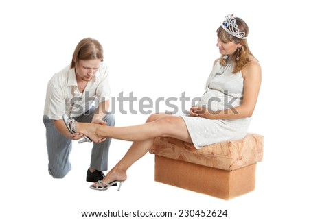 boyfriend helps a happy young pregnant woman - stock photo