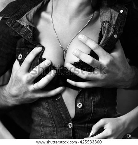 Boyfriend undressing his girlfriend. - stock photo