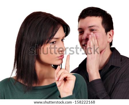 boyfriend whispers a secret to girlfriend - stock photo