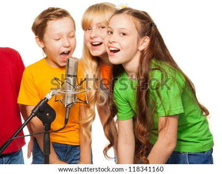 Boys and girls singing in microphone - stock photo