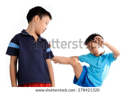 Boys are brother kick and fighting on white background - stock photo