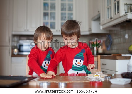 Boys, baking ginger cookies for Christmas