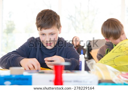 Boys build a kite - stock photo