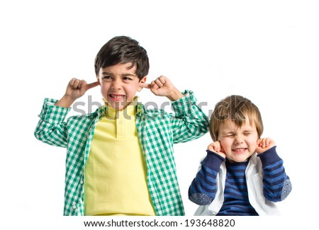 Boys covering his ears over white background.  - stock photo