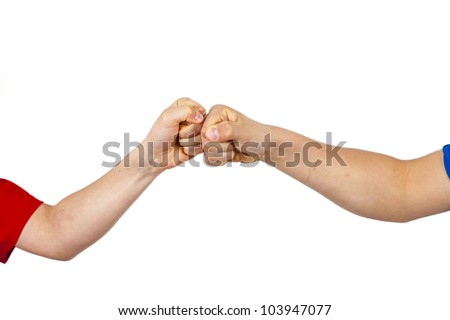 boys greeting each other with fist stroke