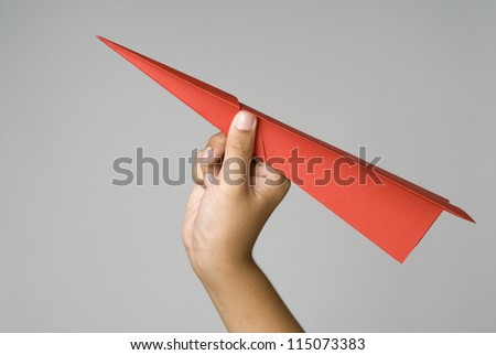 Boys hand holding a paper airplane, Space for text.