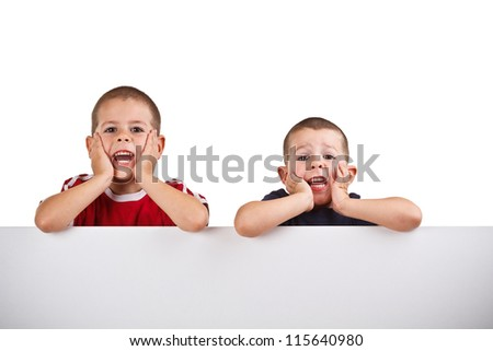 Boys holding a banner isolated on white - stock photo