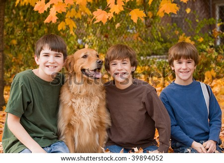 Boys in the Fall Leaves - stock photo