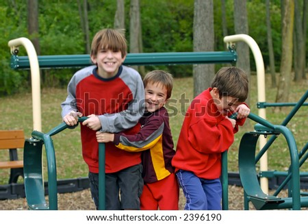 Boys Jumping at the Playground - stock photo