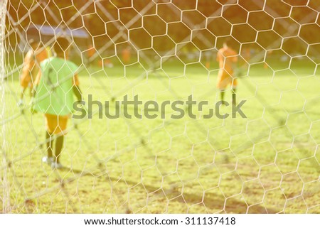 boys kicking football on the sports field,abtract blur - stock photo