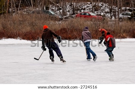 boys  playing hockey outdoors - stock photo