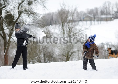 Boys playing snowballs - stock photo