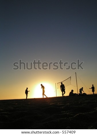 Boys playing volley ball - stock photo
