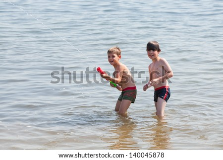 Boys playing with water gun