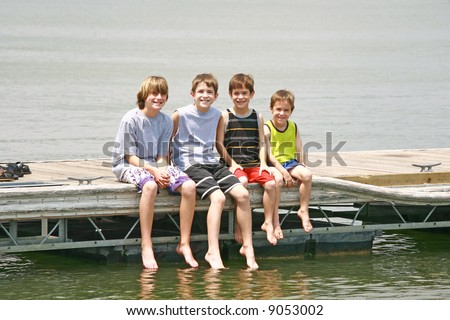 Boys Sitting on the Dock - stock photo
