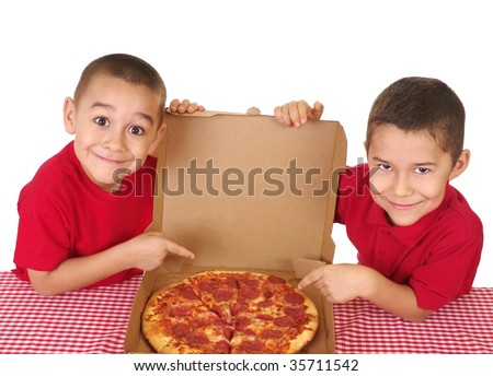 Boys six and seven years old ready to eat a take-out pepperoni pizza - stock photo