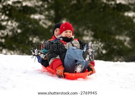 Boys Sledding - stock photo