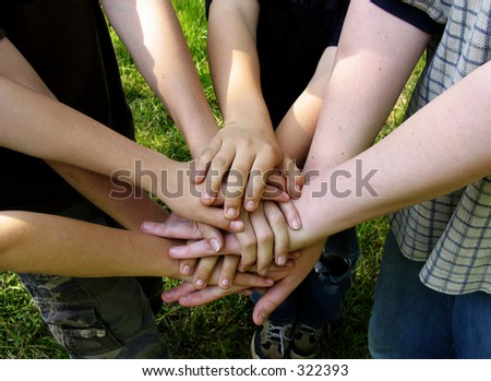 boys' team stacking hands - stock photo