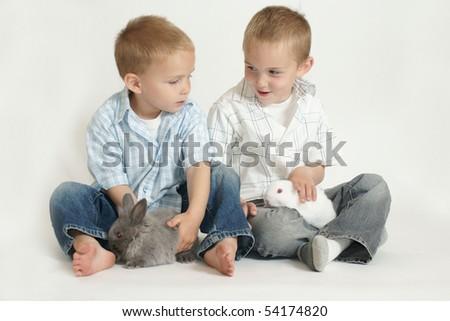 boys with bunnies - stock photo