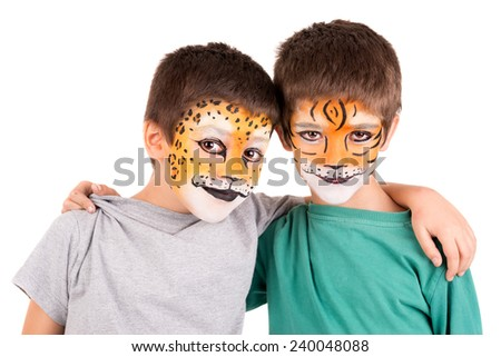 Boys with face-painted like a leopard and tiger isolated in white - stock photo