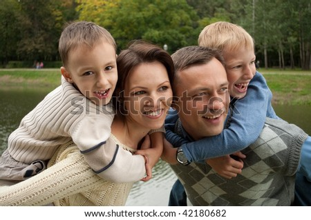 boys with his family in the park