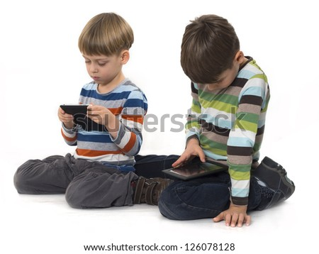 boys with tablet computers isolated on the white background - stock photo