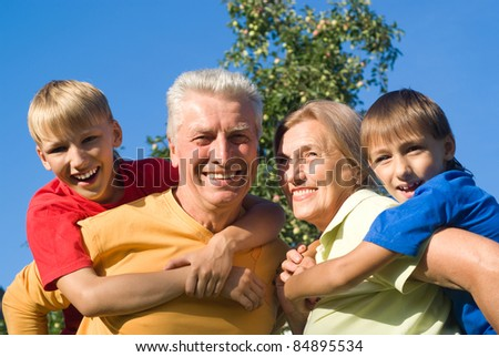 boys with their  grandparents play at nature
