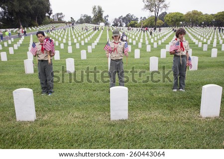Boyscouts place one of 85, 000 US Flags at 2014 Memorial Day Event, Los Angeles National Cemetery, California, USA, 05.24.2014