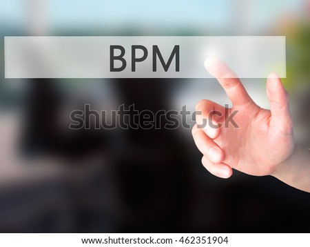 BPM (Business Process Management) - Hand pressing a button on blurred background concept . Business, technology, internet concept. Stock Photo