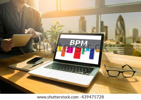BPM - Business Process Management  Thoughtful male person looking to the digital tablet screen, laptop screen,Silhouette and filter sun - stock photo