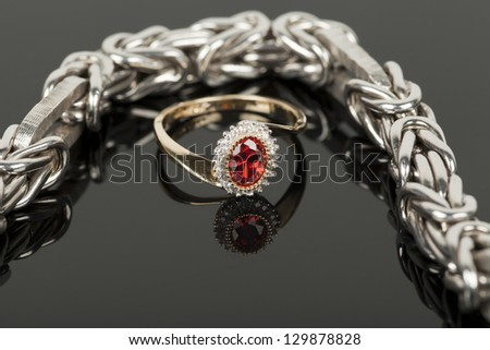 bracelet and ring on black glass