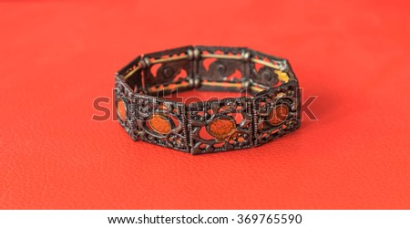 bracelet chinese style on red background for use in chinese new year day. - stock photo