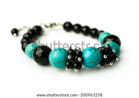 bracelet of turquoise and black onyx isolated on white - stock photo