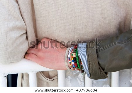 "bracelet on a man's hand with word ""cancer"" - stock photo"