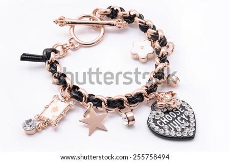 bracelet with pendants on a white background - stock photo