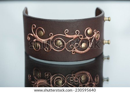 bracelets. ornaments of copper wire - stock photo