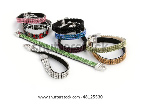 Bracelets with multi-coloured crystals. Isolated on white background.
