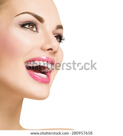 Braces. Beautiful Woman smile close up. Healthy Smile. Closeup Ceramic Braces on Teeth. Beautiful Female Smile with Braces. Orthodontic Treatment. Dental care. Alignment of teeth. Aesthetic dentistry - stock photo