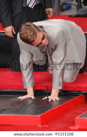 "Brad Pitt at hand & footprint ceremony at Grauman's Chinese Theatre for the stars of ""Ocean's Thirteen."" June 5, 2007  Los Angeles, CA Picture: Paul Smith / Featureflash"