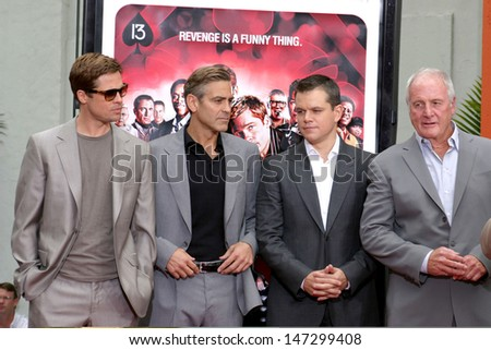 Brad Pitt, George Clooney, Matt Damon, & Jerry Weintraub Handprint & Footprint ceremony For Ocean's Thirteen's at Gruman's Chinese Theater Los Angeles, CA June 5, 2007 - stock photo
